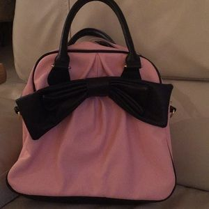 Betsey Johnson pink bag with oversized black bow.